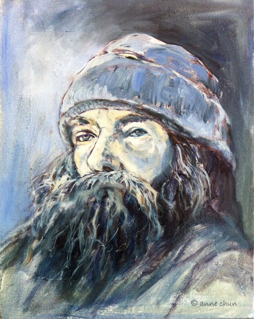 bearded man painting in oil